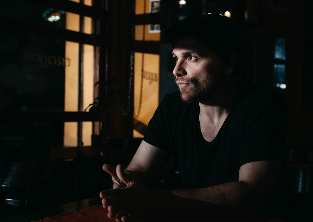 Shot during one of my portrait and lighting workshops in Buenos Aires. Hard light from a zoomed, distant speedlite to create the mood of a night café, with projected shadows. It was actually shot in the afternoon.